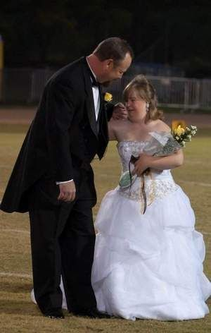 Mitchell Simpson escorts daughter Katelyn Simspon, who was crowned Northwest Rankin High School's homecoming queen Friday night. Katelyn has Down syndrome. Students and faculty members supported an exception to grade requirements to allow her to compete. / Kevin Williams/Special to The Clarion-Ledger