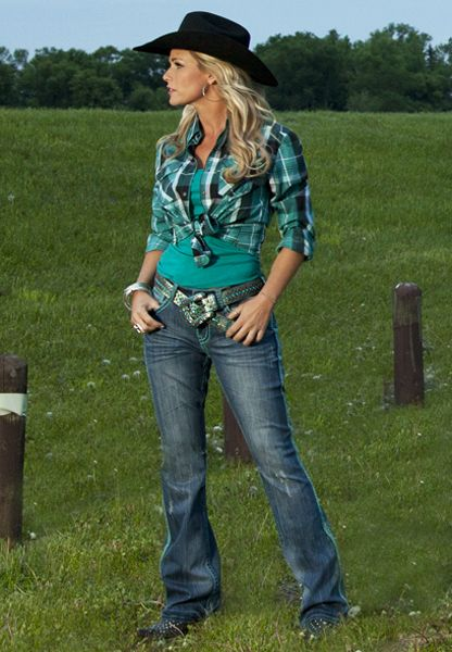 Don't You Dare Fence Me In Emerald Jean by Cowgirl Tuff Company  Dressed to the 9′s! Decked out and ready to roll with heavy turquoise cord stitching making up every seam of this jean. Professional washing detail adds to your look, whiskering around knees and thighs, including a stonewash technique. Barbed wire stitch stands out and is lit with color. Matches perfectly with our April delivery of emerald colors. Medium wash denim.