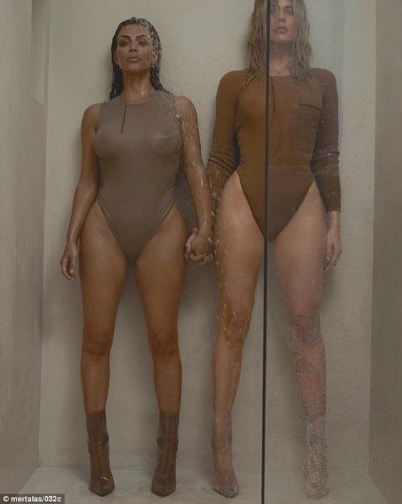 Making a splash: The siblings teamed up again, this time for a shower in sheer body suits: