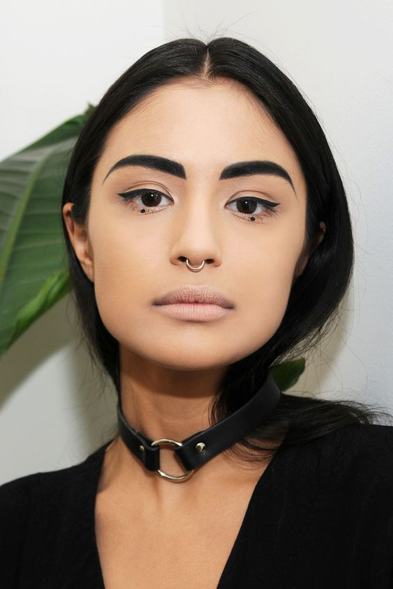 Why I'm Not Ashamed Of My High-Maintenance Makeup Routine #refinery29  http://www.refinery29.com/goth-beauty-ideas-lydia-pang#slide-7  On days when I fancy mixing it up and not wearing my staple black lip, I like to do thicker eyeliner, starting thin in the center and thickening it out at the flick. And I lather on the mascara and separate my bottom eyelashes with tweezers, pulling them into even little shapes. And I add a little central dot; my bestie does this a lot and I think it's so cut...