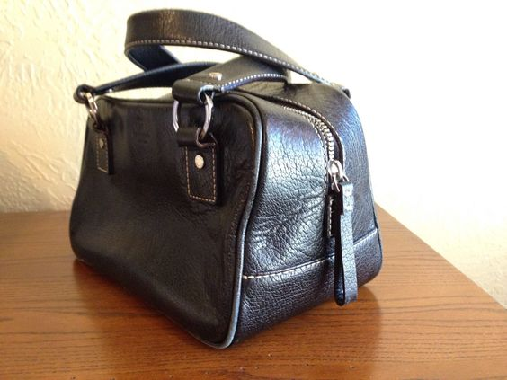 A personal favorite from my Etsy shop https://www.etsy.com/listing/218745947/vintage-kate-spade-leather-barrel-bag