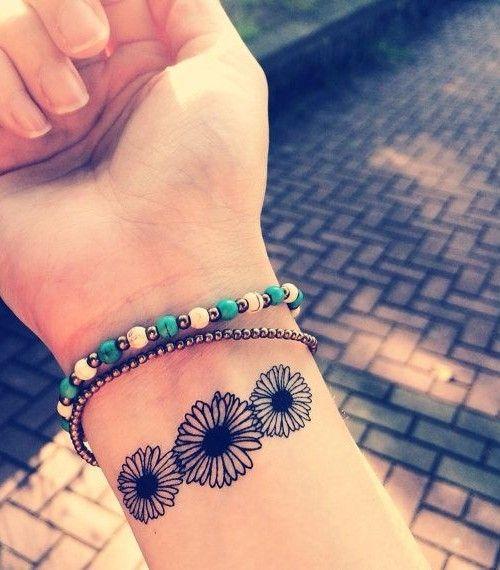 1000 Ideas About Bracelet Tattoos On Pinterest: Cool Black-ink Daisy Bracelet Tattoo On Wrist