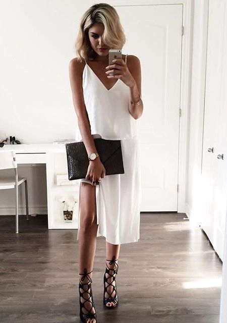 Keep it sexy with a white slip dress and strappy heels.