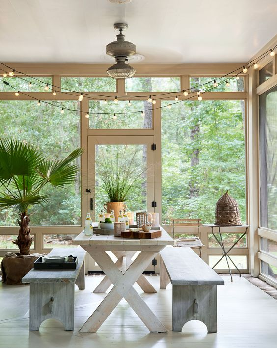 """""""We eat every meal out here,"""" say the owners of the screened-in side porch in this rustic South Carolina getaway. They found the bee skep in an Atlanta garden store.   - HouseBeautiful.com"""