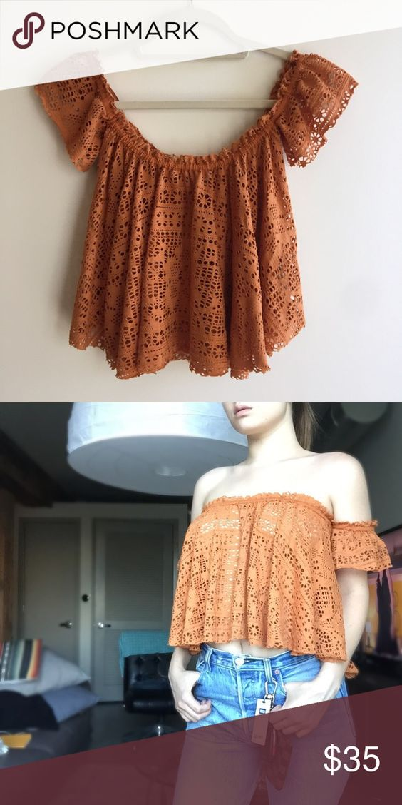 Free People off the shoulder top Such a beautiful orange color and an effortless top! Perfect paired with a bandeau because you can see through the little holes. NWOT 😊 Free People Tops