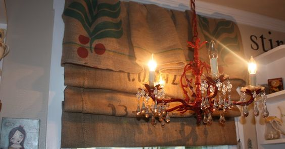 Remember when I said I had a project for the burlap coffee sacks,     When we did a small make over on the kitchen here .... I hung severa...