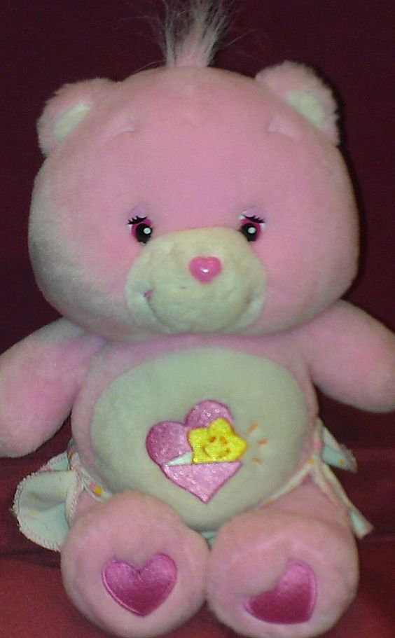 pink baby hugs a bear care bear 10 care bears