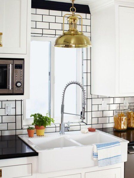 White subway. Black grout. Kitchen backsplash.: