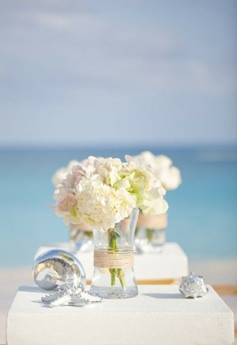 Beach wedding centerpieces shaped vases whites creams