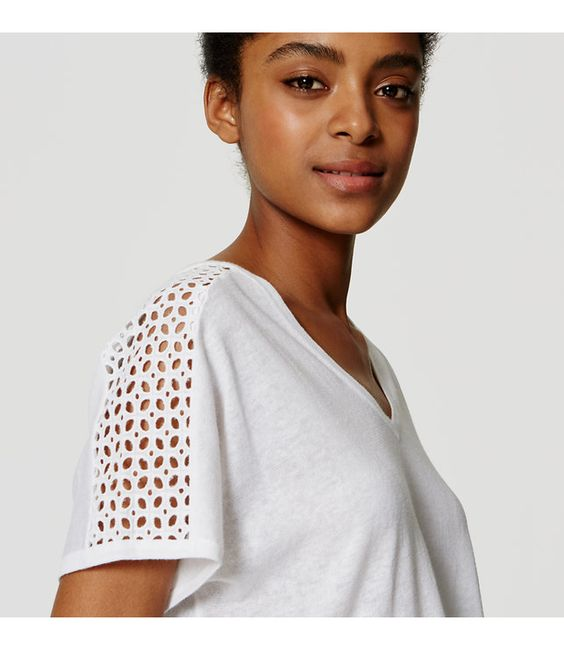 Eyelet detail femmes up this soft and easy linen cotton tee. V-neck. Short sleeves.