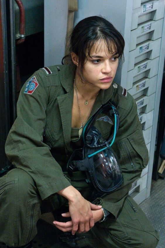 Sexy woman in flight suit waits to board her helicopter