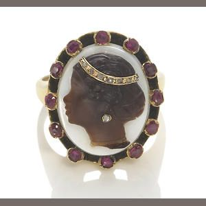 A hardstone blackamoor cameo habillé, ruby and diamond ring, Sold for US$ 976 inc. premium
