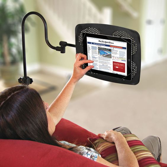 The iPad Adjustable Floor Stand - Hammacher Schlemmer - This is the iPad floor stand that telescopes, tilts, and swivels to hold the device at any position for optimal comfort.