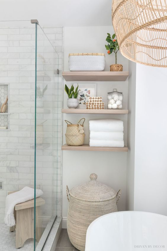The floating wood shelves in our master bathroom!