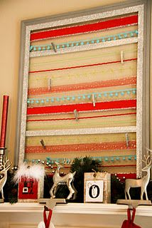 A Christmas Card holder- an old frame spray painted silver, colorful ribbons staple gunned on the back, mini clothespins hold the cards to the ribbons