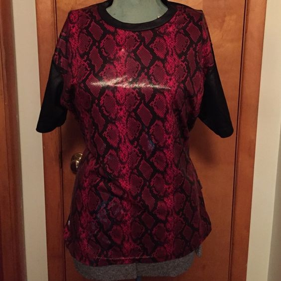 Serious/Hot Topic Shiny Snakeskin Top Red XL Red and black shiny snakeskin pattern shirt purchased at Hot Topic years ago. In great condition except if you turn inside out part of the bottom seam has come undone. Can be easily fixed with fabric glue or by stitching. Shirt is a very fitted XL. Probably more like a large. Serious Tops