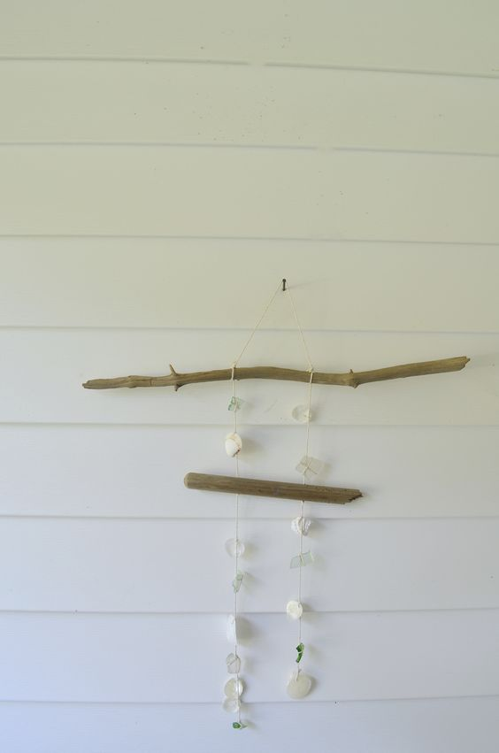 - windchime - created from driftwood, sea shells, cotton twine, & sea glass.