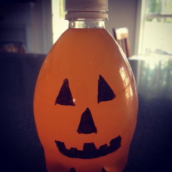 Recycled Aquapod water bottles filled with orange Gatorade.