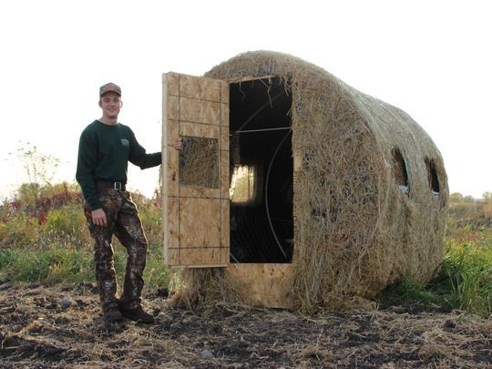 Jason Combs shows off his deer blind near New London.
