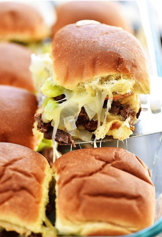 Slider sandwiches loaded with steak, cheese, peppers and onion. Delish!