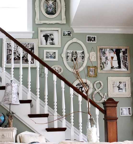 Decorating with Empty Thrift Store Frames - Black and white photos, staircase wall: