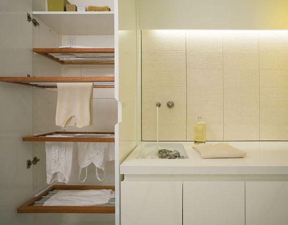 modern laundry room with hidden custom drying rack bright modern laundry room