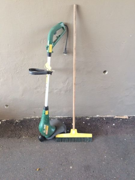750w trimtech grass cutter and lasher rake.Used once