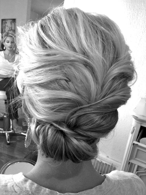 Textured Twisty Low-Do... i want my hair like this for my wedding.