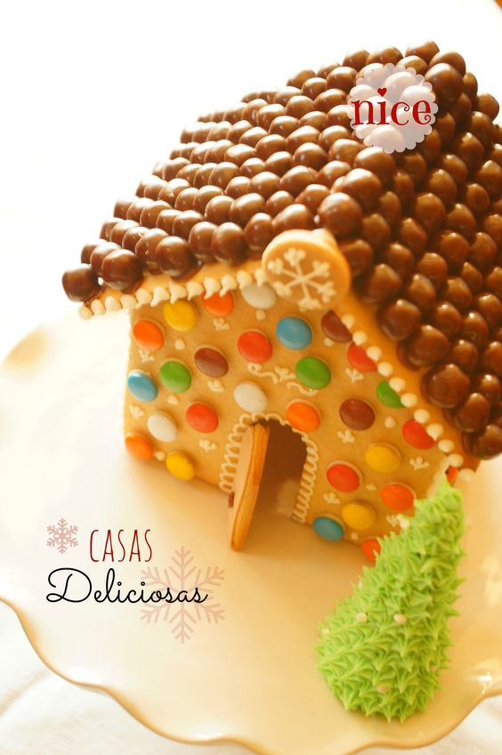Adorable gingerbread house with malted chocolate balls on roof
