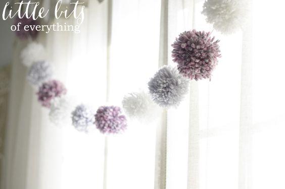 Very cute pom pom garland in the window of a nursery - #nursery #pompom