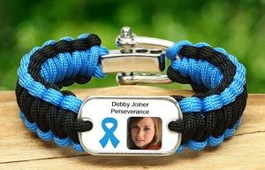 Survival Straps :: These come in a variety of awarness ribbons :: Medical ID :: And also just the ribbon w/o a picture.   I like this because it is masculine and not much as a dad that I can show my support daily with.