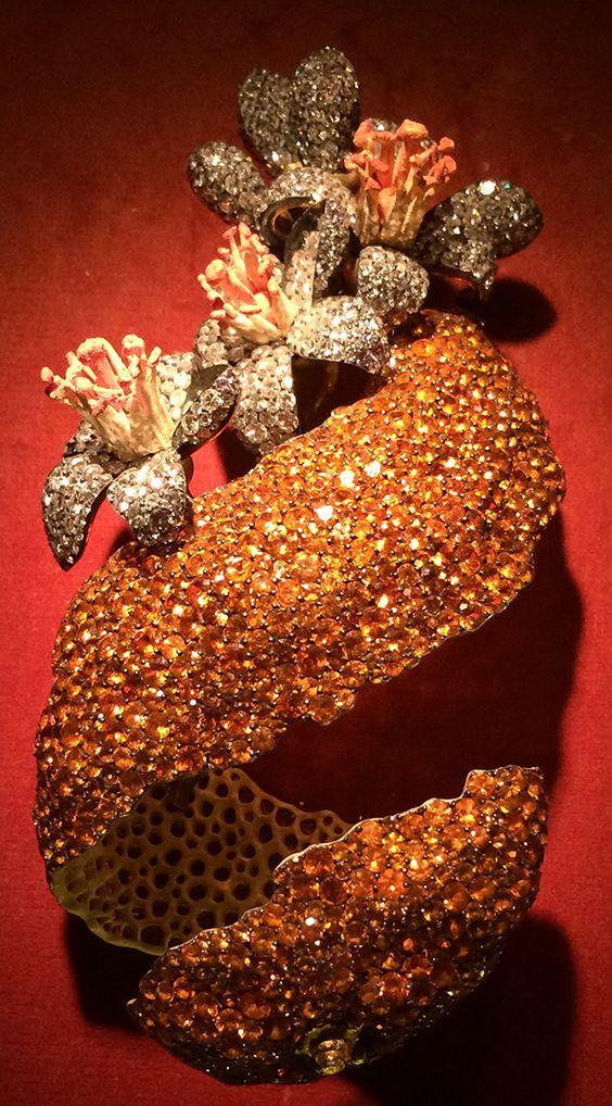 H & D Diamonds is your direct contact to diamond trade suppliers, a Bond Street jeweller and a team of designers.www.handddiamonds... Tel: 0845 600 5557 - Orange Peel Brooch by JAR, garnet, diamond, enamel, silver, gold, 2001. Photo by Cheryl Kremkow, cherylkremkow.com.