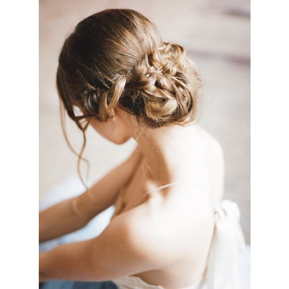 """""""If you live and breath SMP, you know we LOVE all things #bridalhair, and this messy #braidedchignon is everything! #chignon #weddinghair #hairinspiration   Photography"""