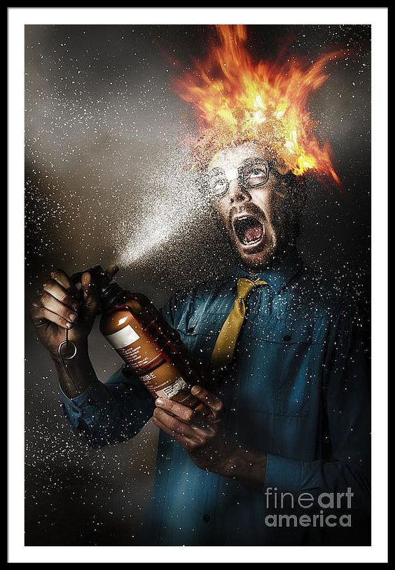 Danger Framed Print featuring the photograph Hot Headed Nerd Businessman Playing With Fire by Ryan Jorgensen