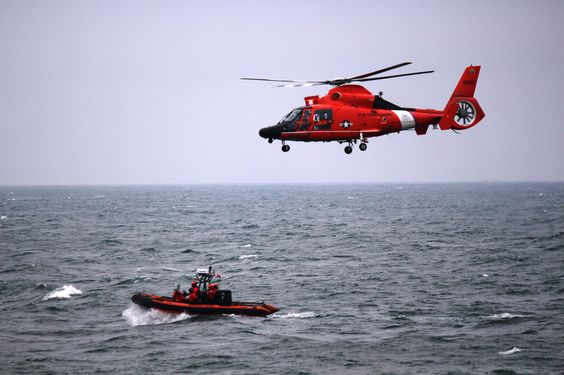 A small boat crew from the Coast Guard Cutter Mellon conducts air operations training with a MH-65 Dolphin helicopter crew while underway May 27, 2015. The crew of the Mellon, a 378-foot high-endurance cutter homeported in Seattle, has been patrolling the high seas in search of illegal, unreported, and unregulated fishing activity in support of Operation North Pacific Guard. (U.S. Coast Guard photo)
