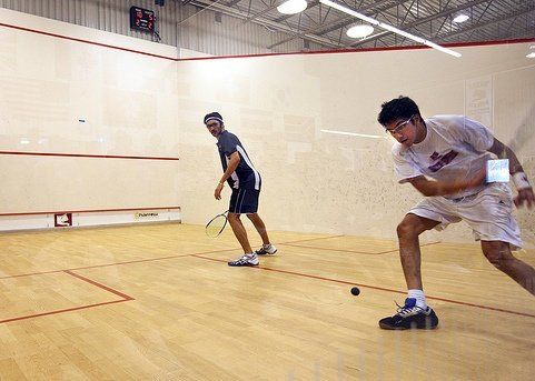 Kush Mahan practicing his squash game with a friend