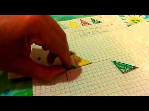 Traslación, rotación y reflexión de triángulos