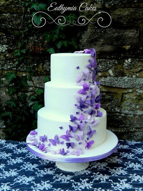White Wedding Cake With Purple Butterflies By Euthymia Cakes