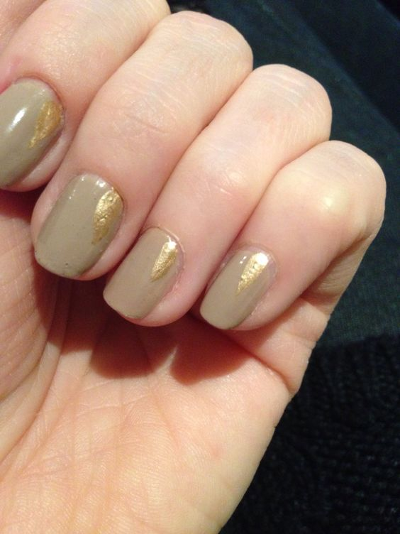 Nude with a golden teardrop. Simple nail art.