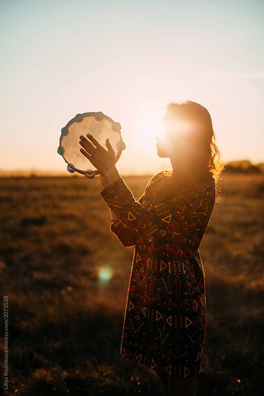 Side View Portrait Of Incognito Female Wearing Stylish Dress With Geometric Pattern And Playing Tambourine I Free Spirit Photography Sunset Pictures Tambourine