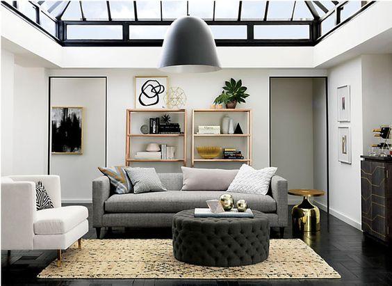 Salón decorado en tonos grises