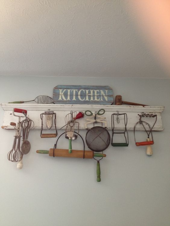 old vintage wooden and wire kitchen utensils on display as art ...