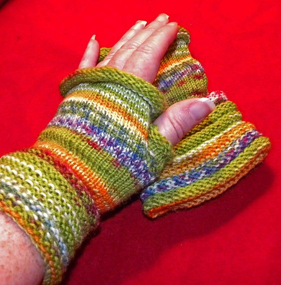 Fingerless gloves using sock yarn and knittingboards sock loom by Lea Co...