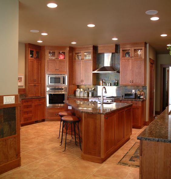Triangle Kitchen Island warm, inviting kitchen with high display cabinets, triangle shaped