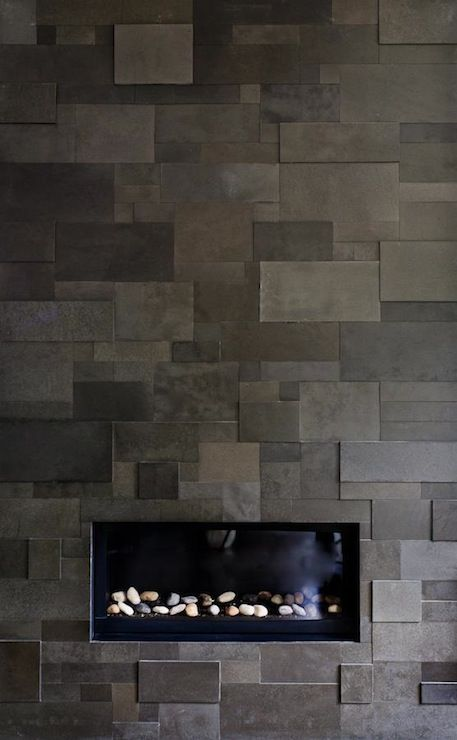 Suzie: Michael Abrams Limited - Sleek gray modern fireplace with slate tiles.---we could do this for the backsplash...it'd be a lot of cutting, but totally worth it.