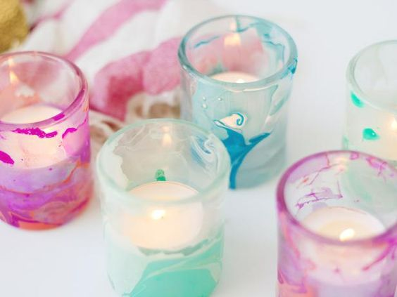This simple technique using water and nail polish will transform basic candleholders into marbled showpieces for your summer table.