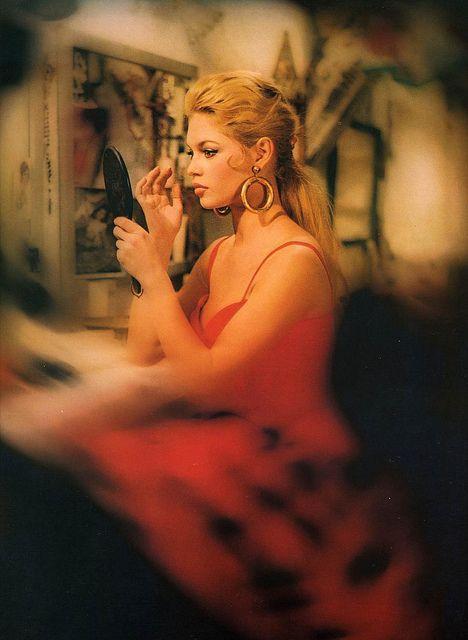 """Brigitte Bardot on the film set of """"La Femme et le Pantin."""" Photo by Roger Corbeau, 1958."""