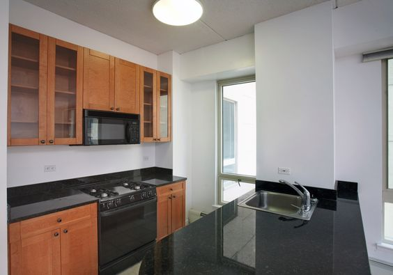 Modern kitchen and granite counter tops in Chelsea Place apartment building.
