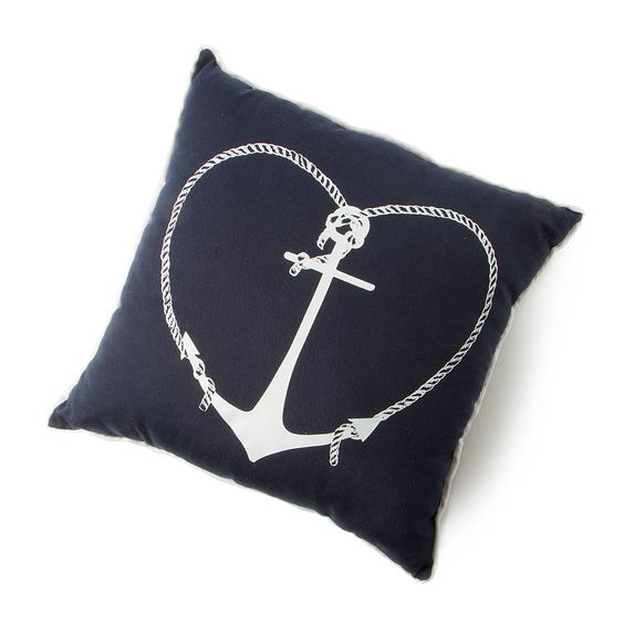 Adorn your home with nautically inspired style with this navy pillow that has a white heart anchor on the front and white trim around the edges.
