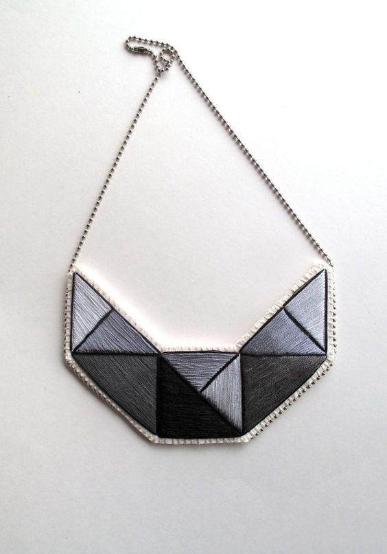 Bib necklace hand embroidered with light and dark grays and black outline